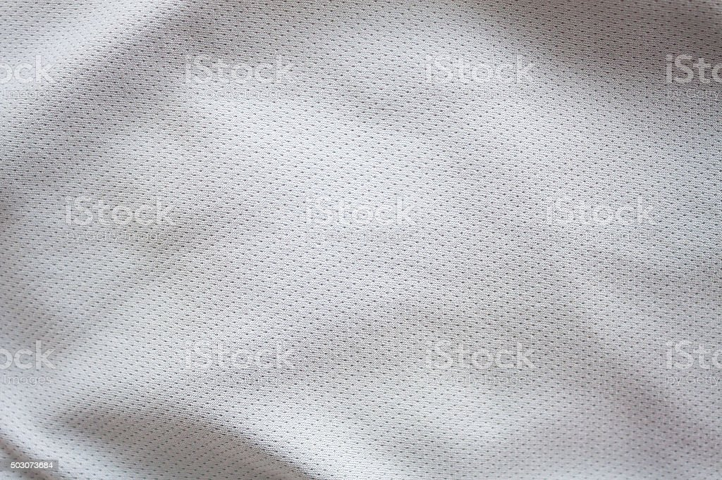 Close up shot of white textured football jersey stock photo