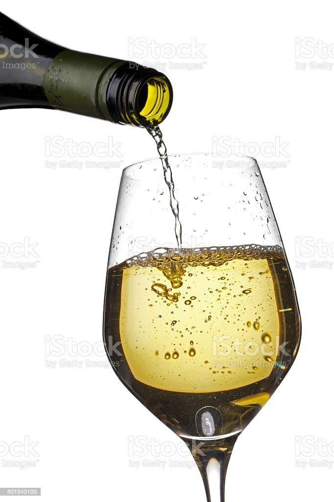 close up shot of wine bottle and wine glass stock photo