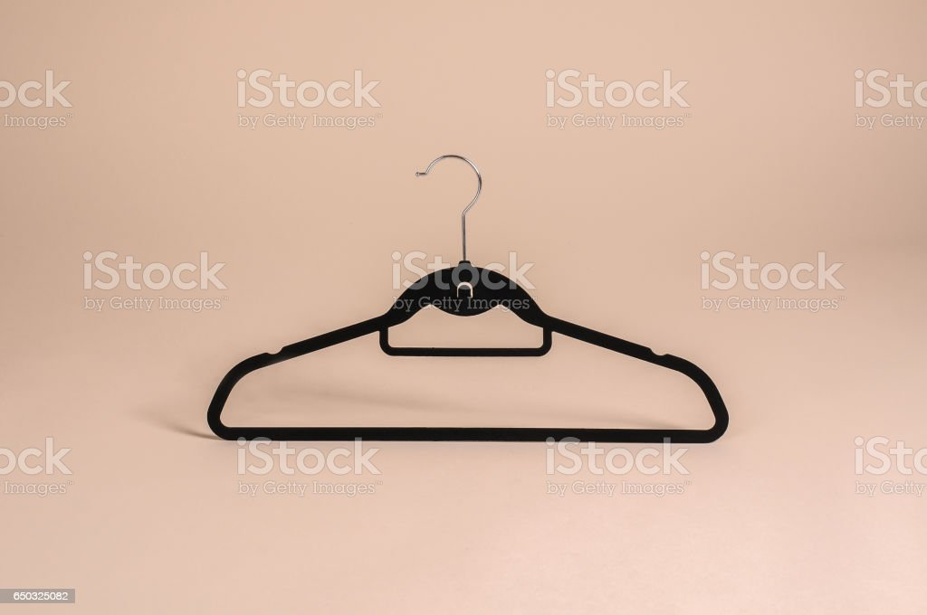 A close up shot of wooden clothes hange stock photo
