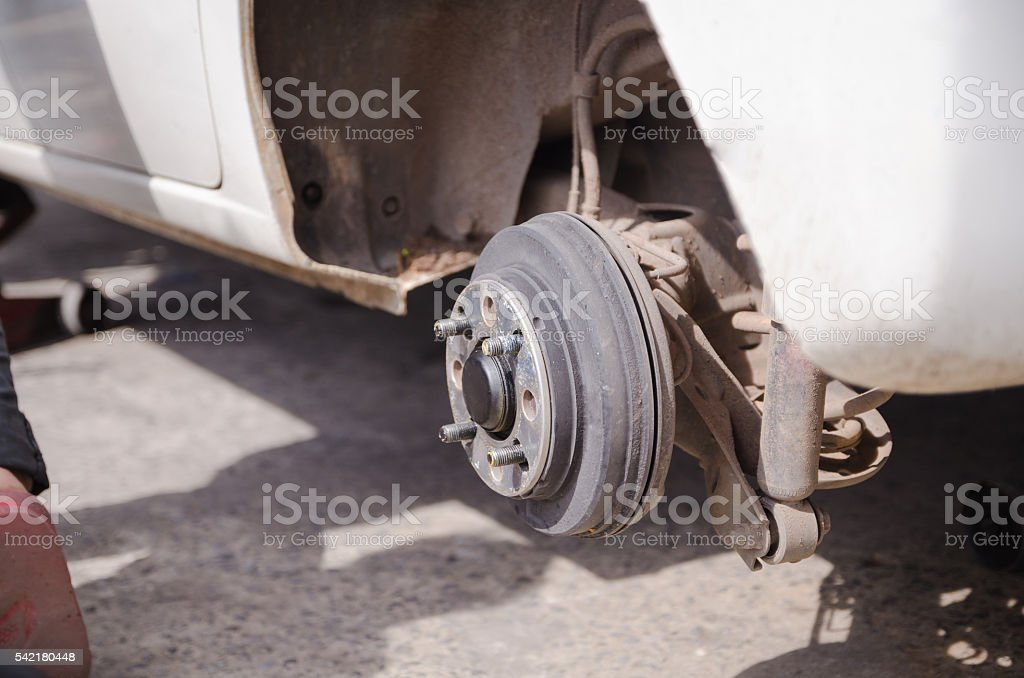 Close up shot the wheel axle of the car vehicle stock photo