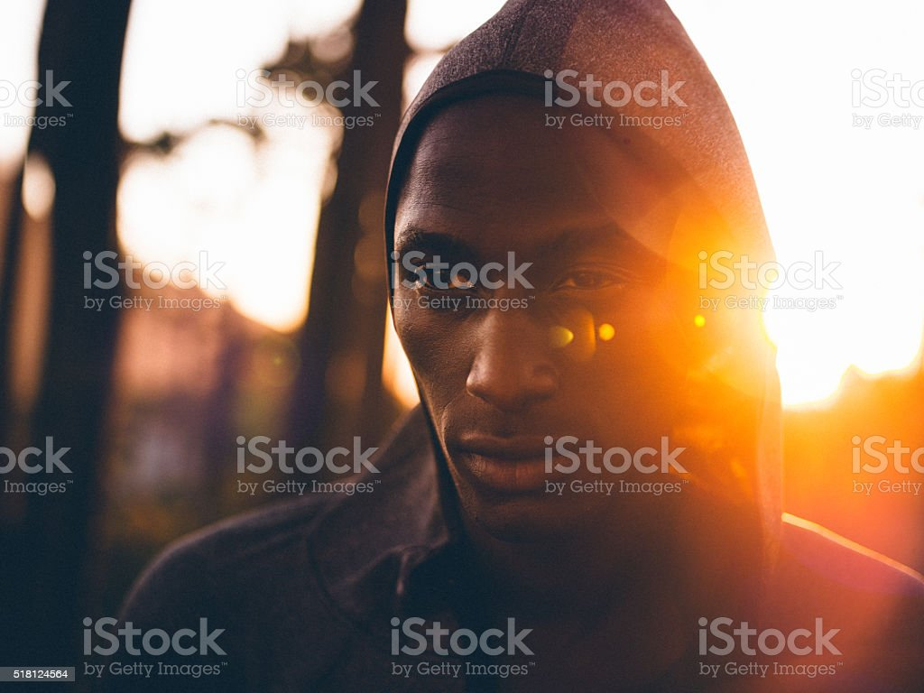 Close up shot with lens flare of determined african-american ath stock photo