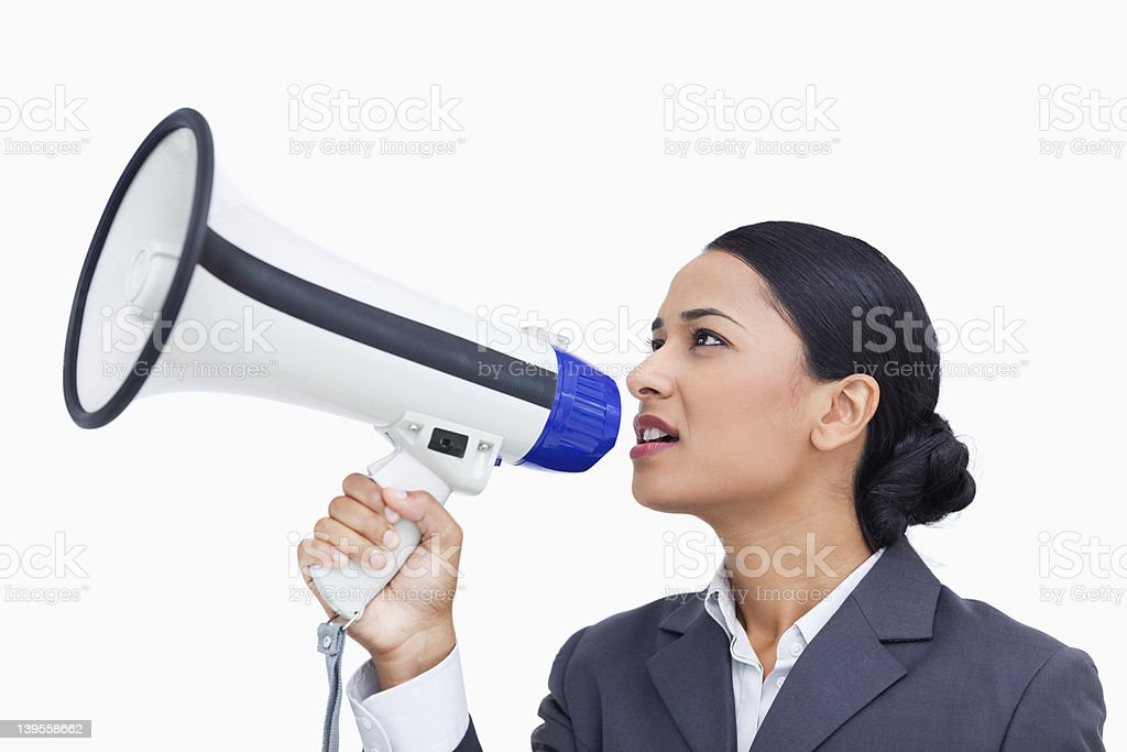 Close up side view of saleswoman using megaphone stock photo