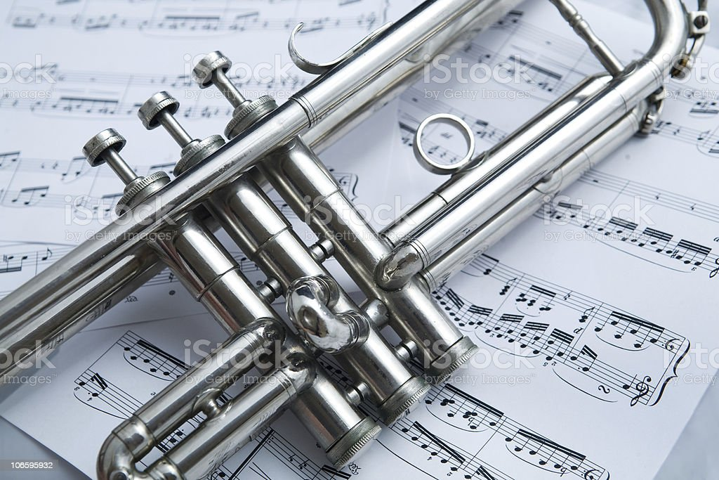 Close up silver trumpet on a background of music notes royalty-free stock photo