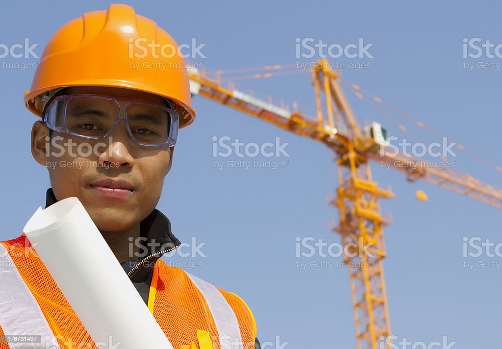 Close up site manager with safety vest under construction stock photo