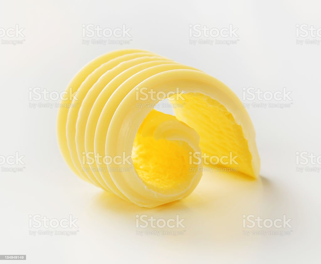 Close up slice of textured curled butter stock photo
