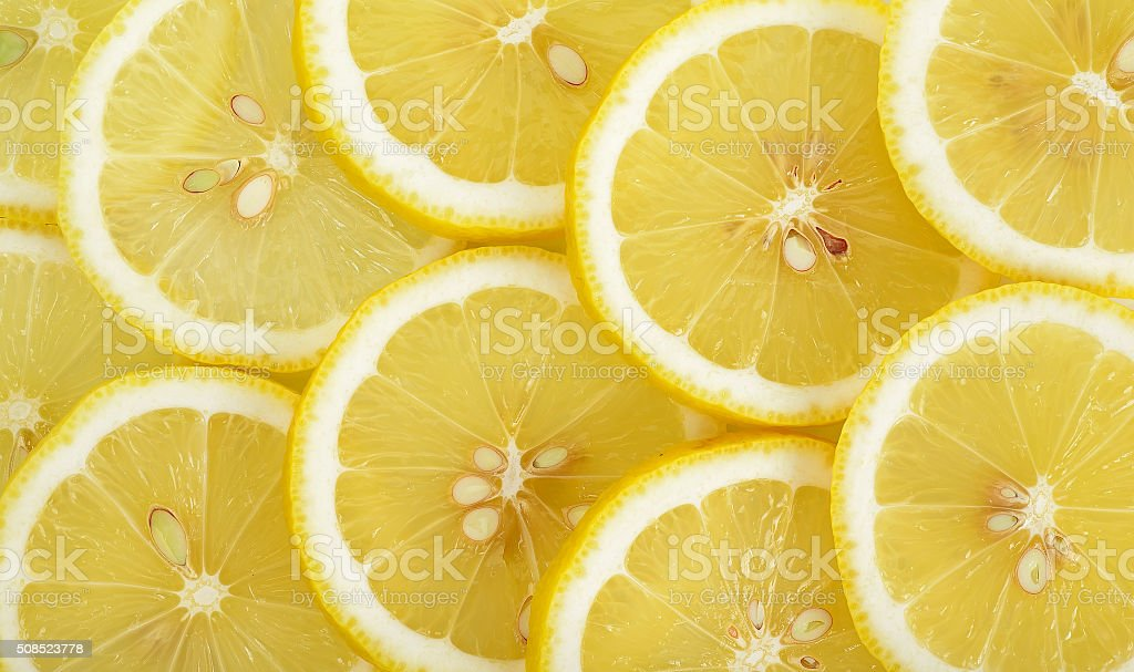 Close up sliced yellow lemon background texture stock photo