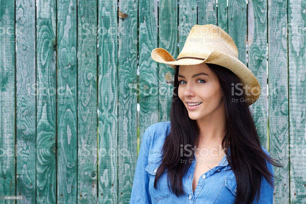Close up smiling woman wearing cowboy hat stock photo