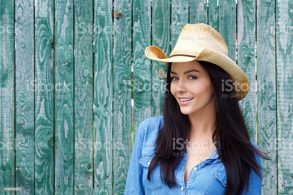Close up smiling woman wearing cowboy hat stock photo