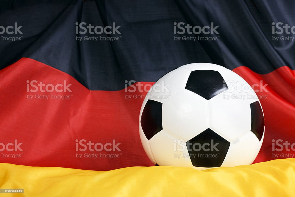 Close up soccer ball on German flag royalty-free stock photo