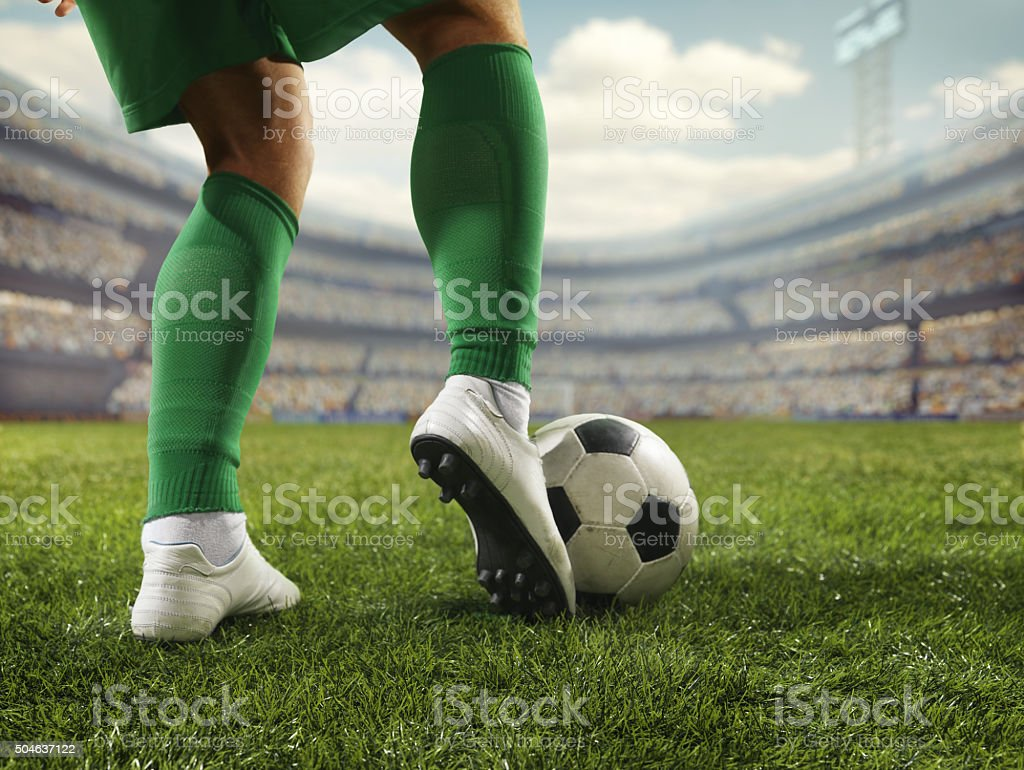 Close up soccer player with ball stock photo