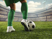 Close up soccer player with ball