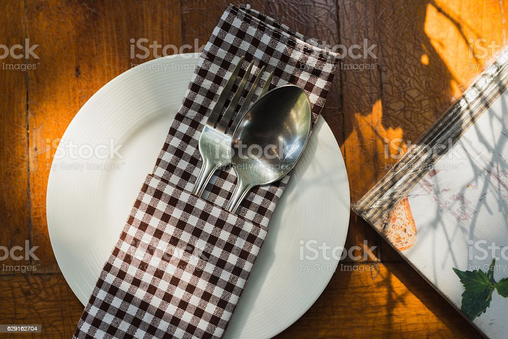 Close up Spoon and For on wood table stock photo