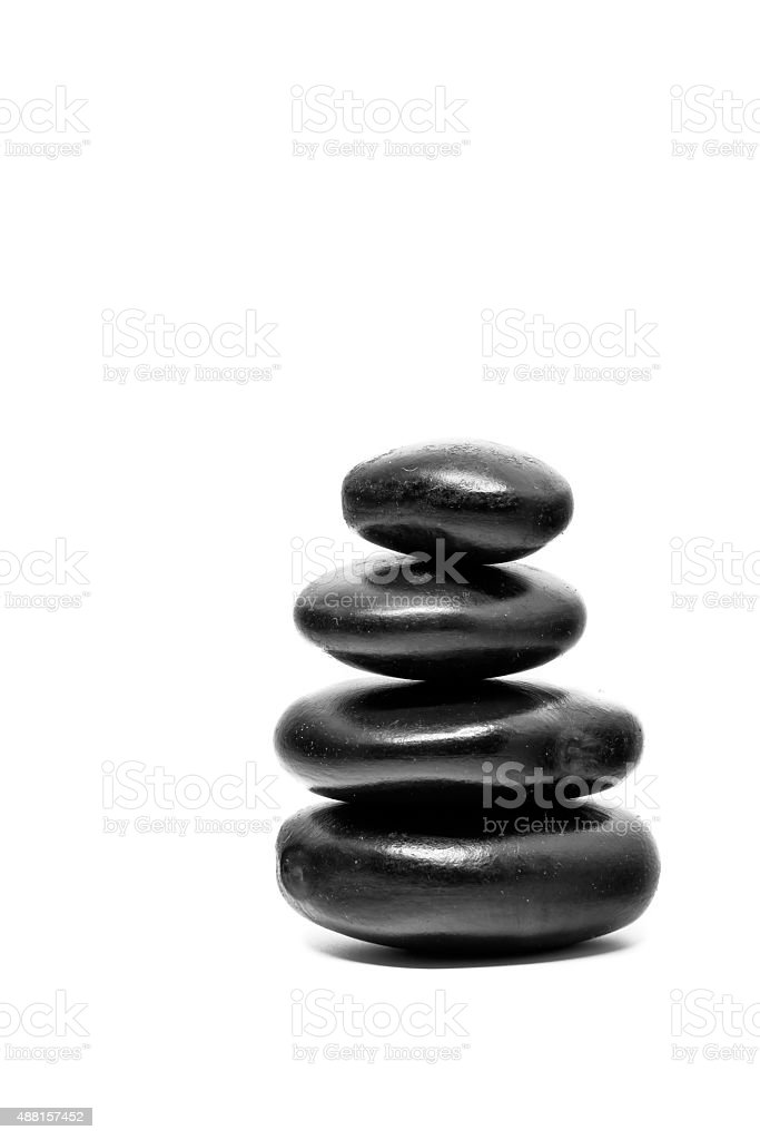 Close up Stack of spa hot stones isolated on white stock photo