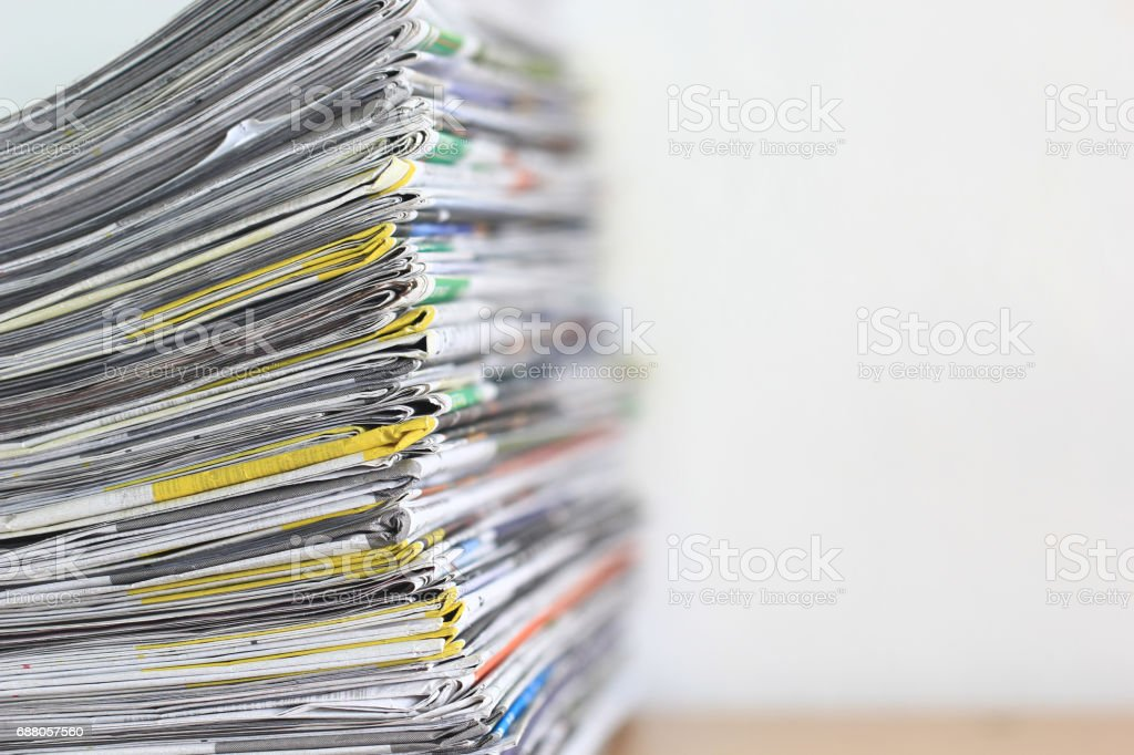 Close up stacking of Newspaper on wooden table, global communications concept stock photo