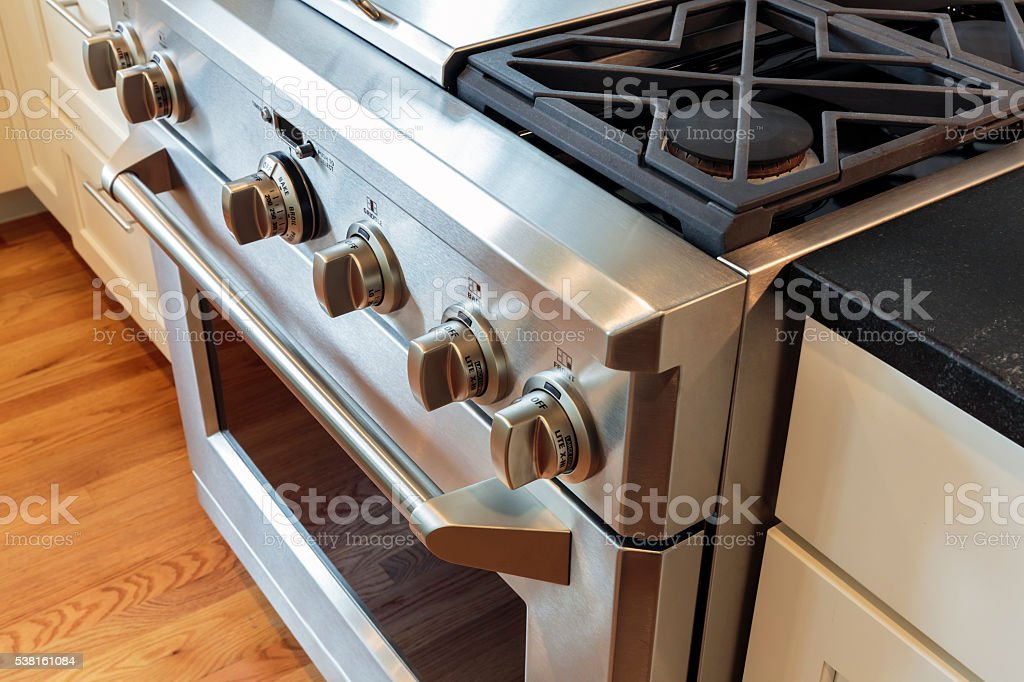 Close up stainless steel stove with oven stock photo
