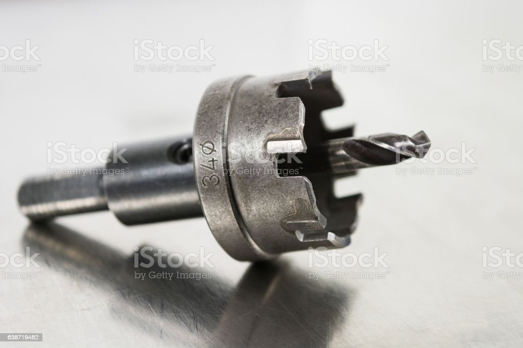 Close up steel drill bit  on stainless steel background. stock photo