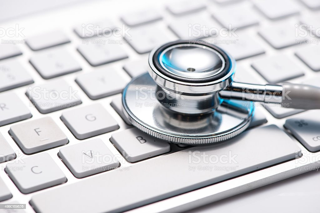 Close up stethoscope on a keyboard stock photo