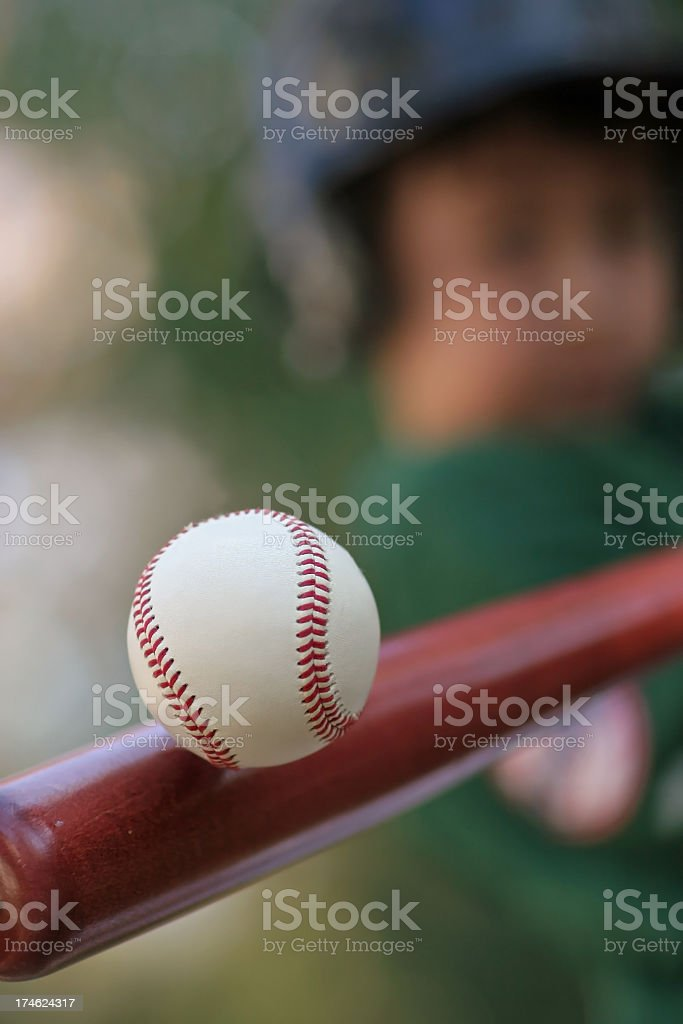 Close up still image of a baseball making contact with bat stock photo