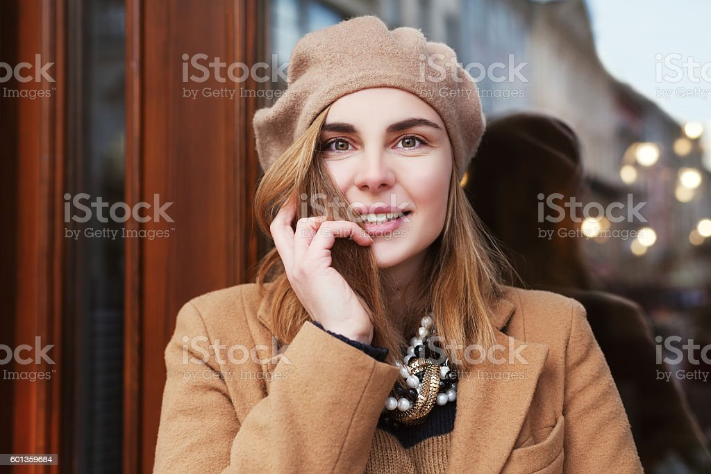 Close up street portrait of young beautiful happy smiling woman stock photo