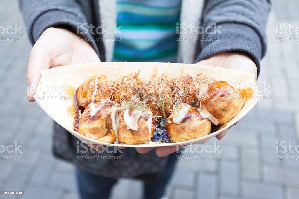 close up takoyaki on hand women in  Osaka Japan stock photo