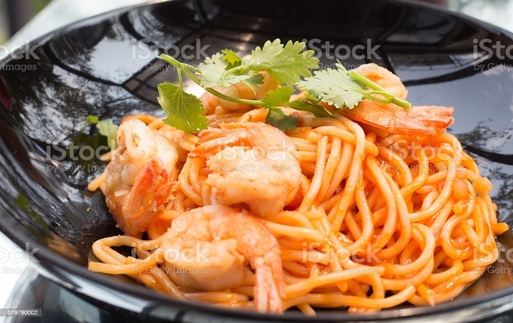 Крупным планом блюда спагетти с помидорами-соусом развилке Стоковые фото Стоковая фотография