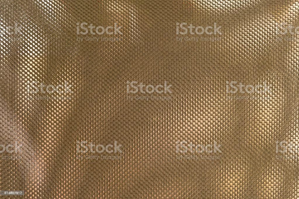 Close Up Texture Background of Bronze Polyester Fabric stock photo