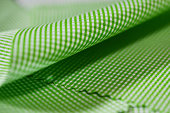 close up texture green and white pattern fabric of shirt