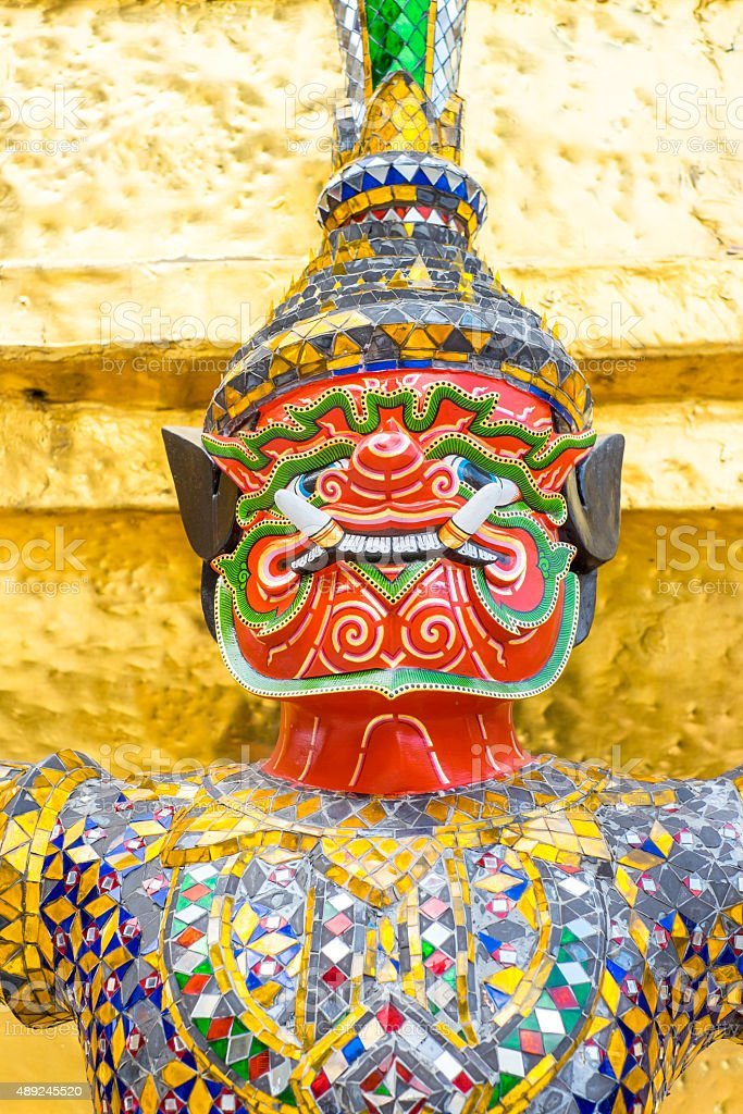 Close up Thai giant statue at golden pagoda stock photo
