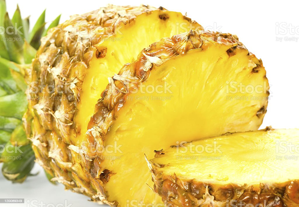 Close up thick slices of fresh pineapple fruit royalty-free stock photo