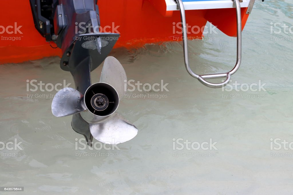Close up three blade stainless impeller of motor boat stock photo