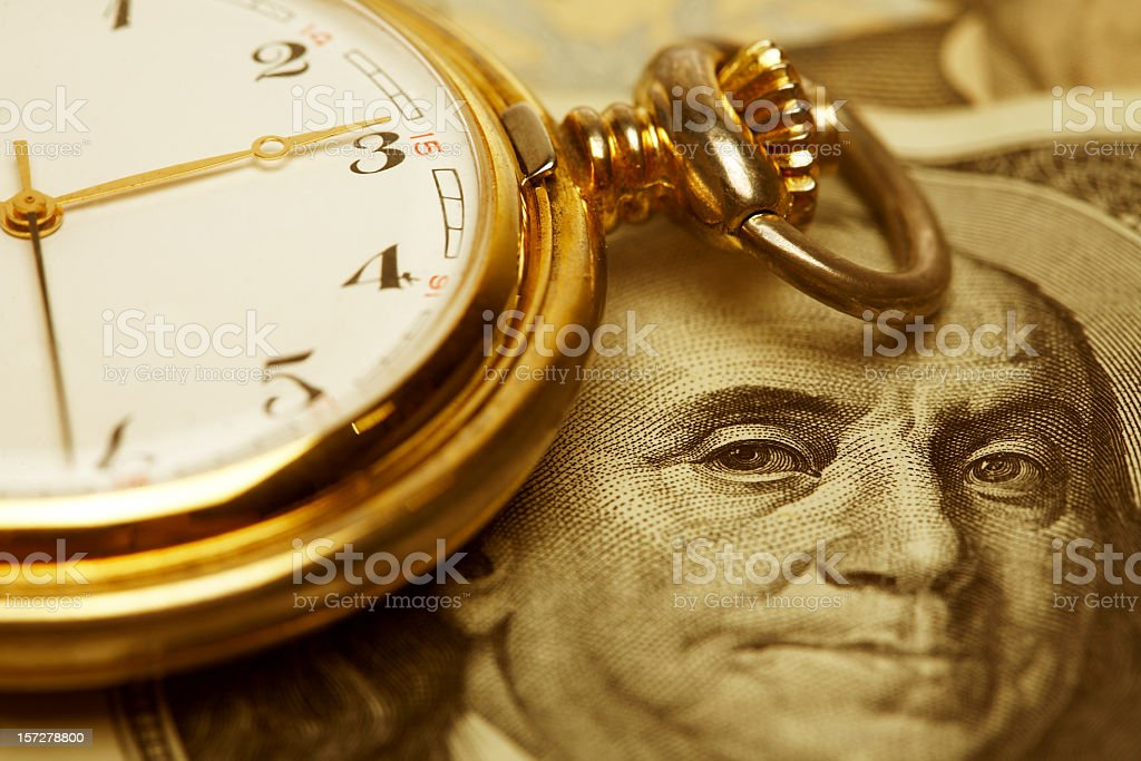 Close up, Time and Money. Gold Tone. stock photo
