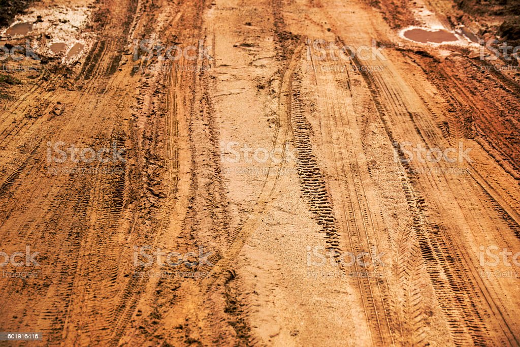 Close up Tire marks on the Dirt road stock photo
