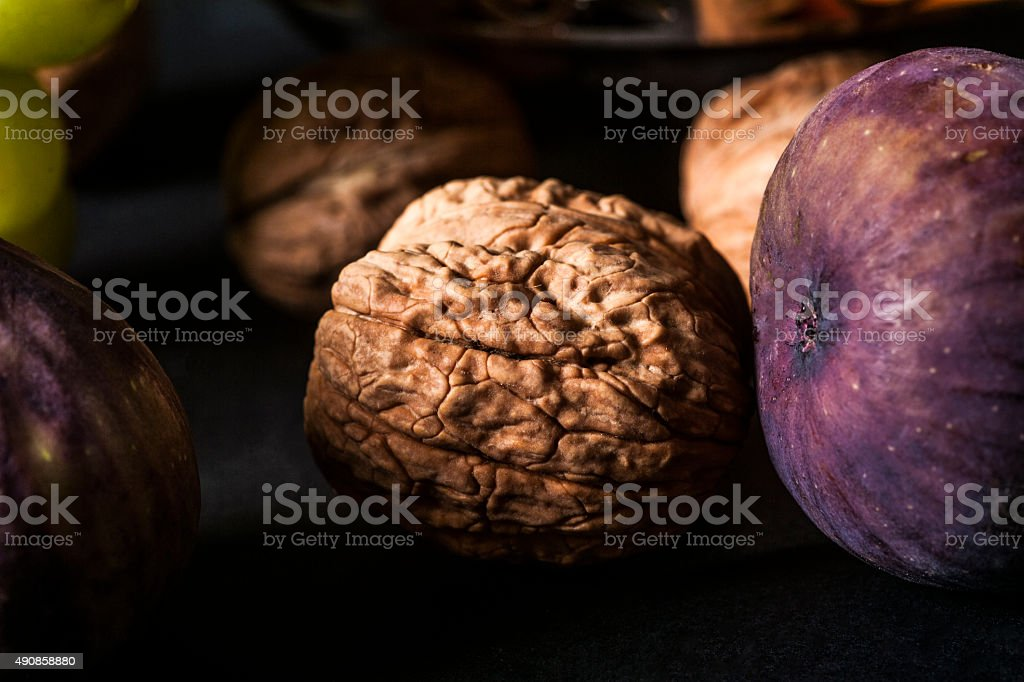 Close up to a dark fic and a nut stock photo