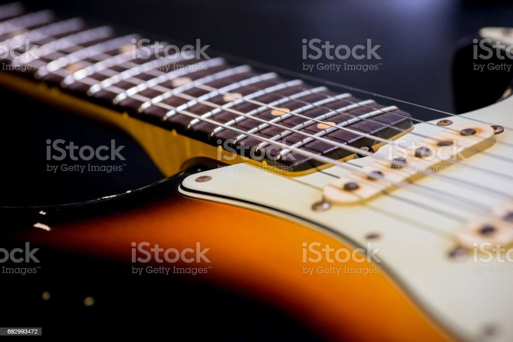Close up to the vintage electric guitar neck stock photo
