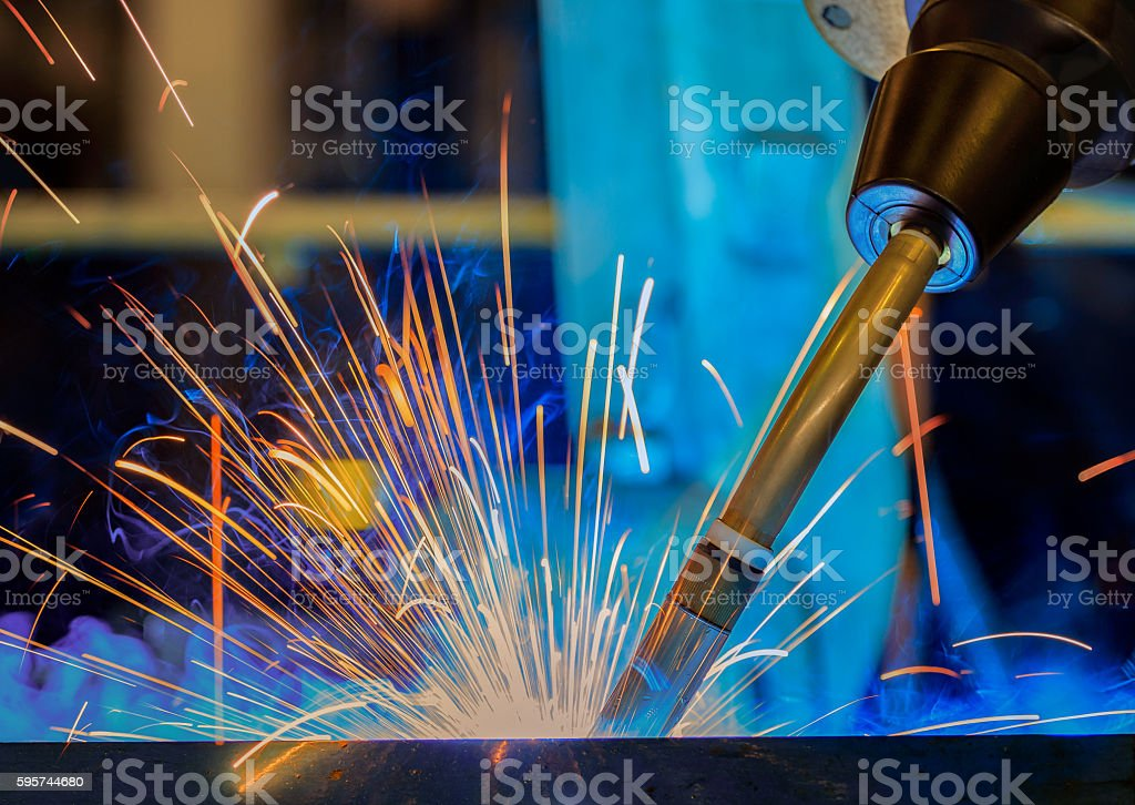 Close up torch body robot welding. stock photo