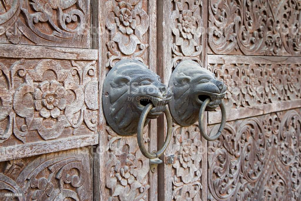 Close up traditional Thai style wooden door royalty-free stock photo