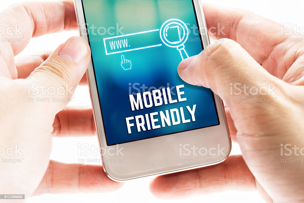 Close up Two hand holding mobile phone with mobile friendly stock photo