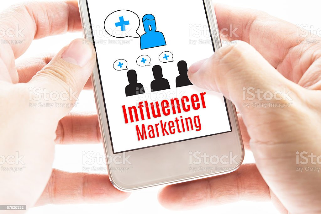 Close up Two hand holding smart phone with Influencer Marketing stock photo