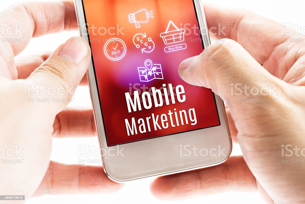 Close up Two hand holding smart phone with Mobile Marketing stock photo