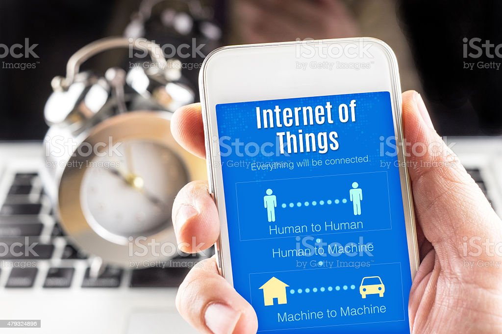 Close up Two hand holding smartphone with Internet of things stock photo