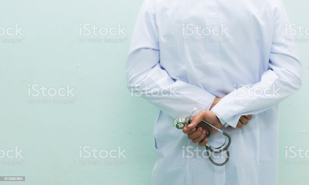 Close up unknown doctor and stethoscope on white background stock photo