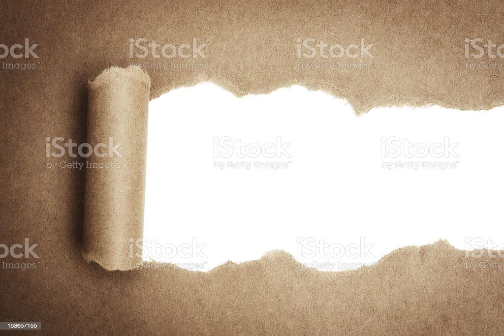 Close up view of a brown paper bag being torn open stock photo
