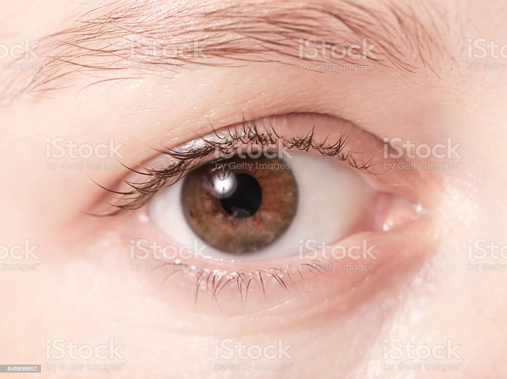 Close up view of a brown woman eye looking at camera stock photo