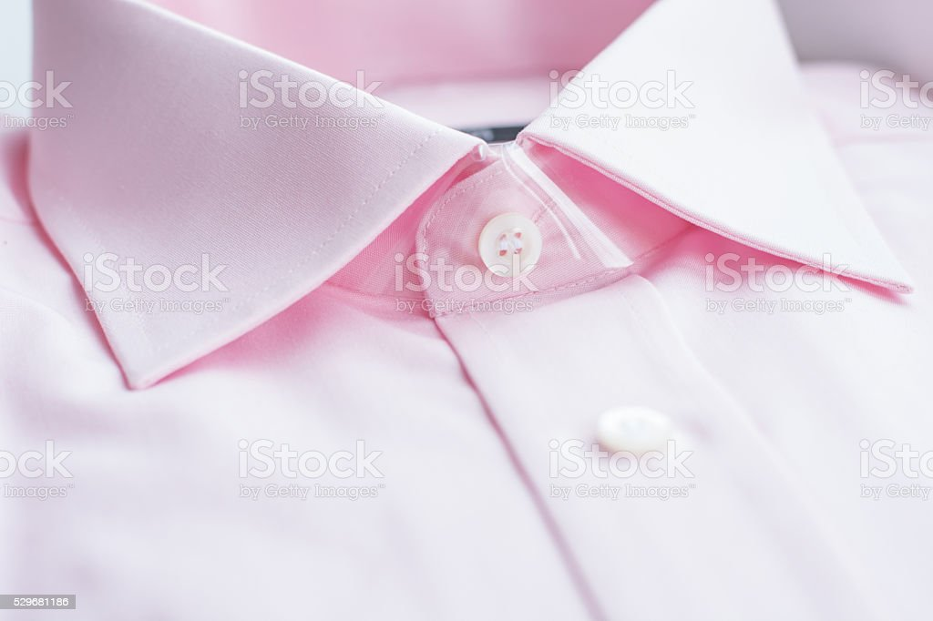 Close up view of a generic pink business shirt. stock photo