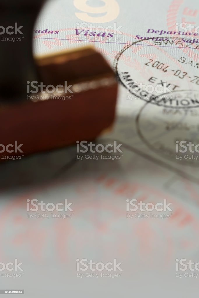 Close up view of a passport with immigration stamp royalty-free stock photo