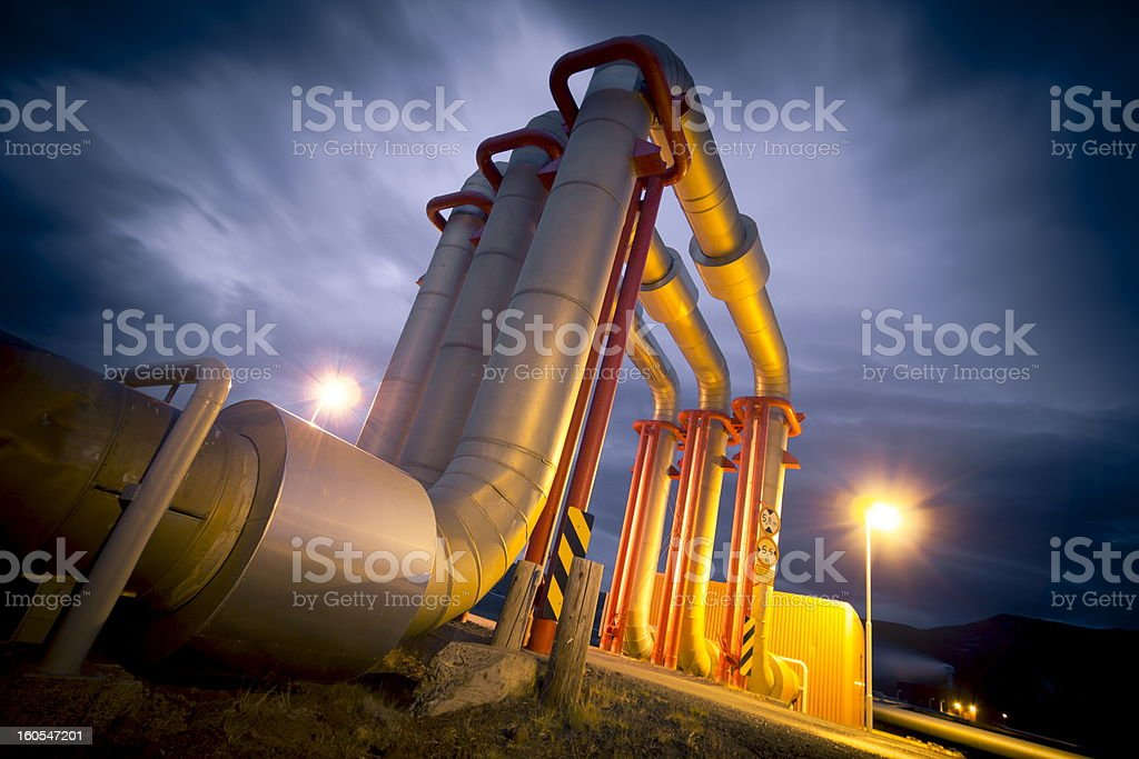 Close up view of a pipeline at night stock photo