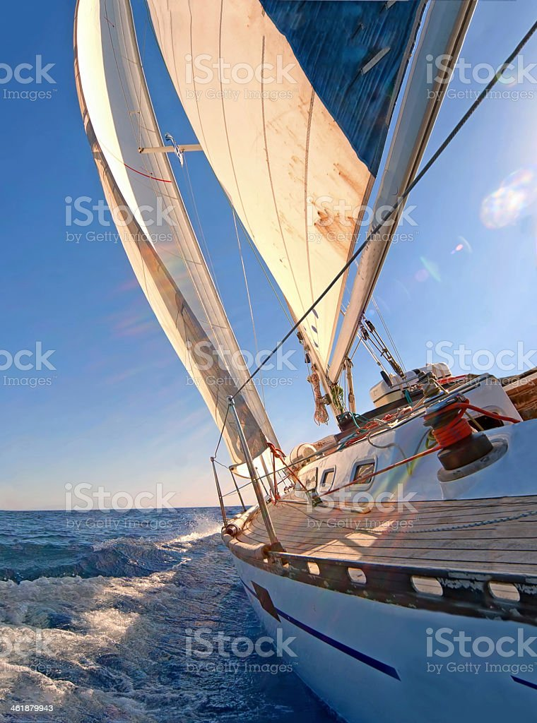 Close up view of a sailing yacht boat on the ocean stock photo