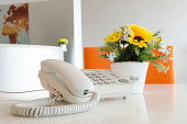 Close up view of a work desk interior with telephone