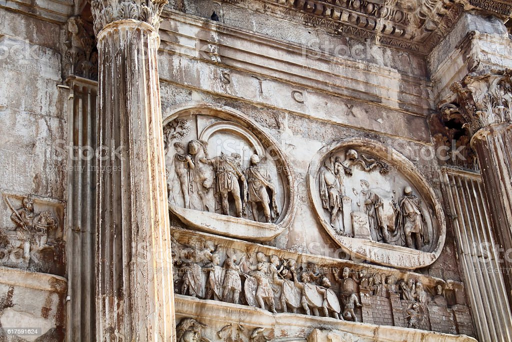 Close up view of arch of Constantine (Arco di Costantino) stock photo