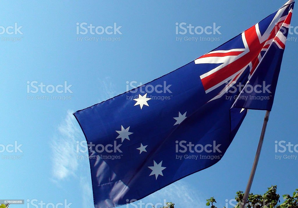 Close Up View Of Australian Flag Against Clear Blue Sky stock photo